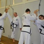 Black belts have trained to become strong and flexible